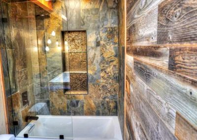 Remodeled bathroom with new shower glass enclosure